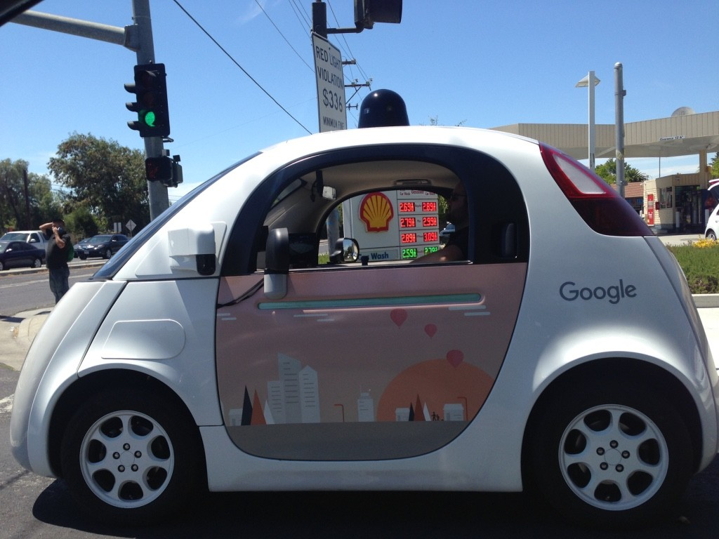 "Google's autonomous car is spotted with a ""driver"" on the road."